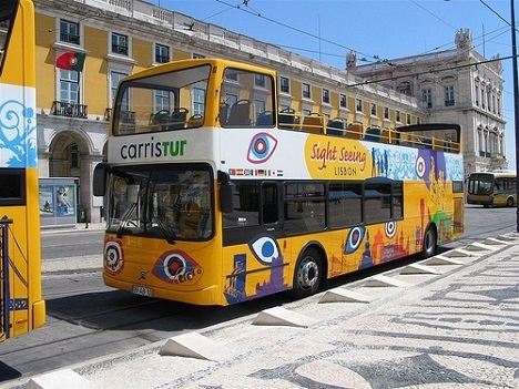 Yellow open top bus in Praca da Liberdade